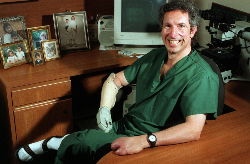 mount everest Dr. Beck Weathers sits in his office at Columbia Medical City Dallas Hospital in Dallas on Monday, May 5, 1997, where he is relearning his job as a pathologist. A year prior, he lay snow-blind, frost-bitten and in a hypothermal coma a few hundred feet from the summit of Mt. Everest. A sudden storm claimed eight lives of his party, the worst disaster ever on Everest. His right arm was amputated; he lost the fingers of his left hand; and his nose was also removed. Weathers has undergone eight major surgeries. (AP Photo/Dallas Morning News, Natalie Caudill)